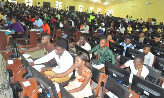 Some candidates in one of the Examination Halls.