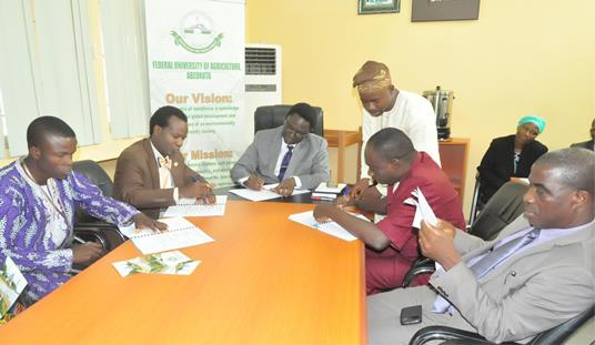 The Vice-Chancellor, Prof. Olusola Oyewole (middle), signing the MoU, while the  Regional Manager, Arewa Cotton, Mr. Bayo Olayemi (2nd Left) does same. With the Vice-Chancellor are the DVC (D), Prof. Felix Salako (2nd Right) and the Bursar, Mr. Moses Ilesanmi (Right).