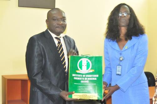 The Acting Registrar of ICCON, Dr (Mrs) Taiwo Bammodu (Right), presenting a gift to the DVC (D), Prof. Felix Salako, who represented the Vice-Chancellor at the occasion.